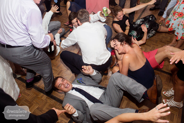 Wedding guests on the ground during the song shout.