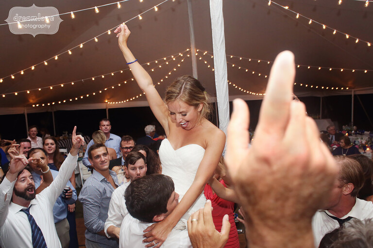 Amazing photo of the groom picking up the bride on the dance floor at the end of their Cape Cod wedding.