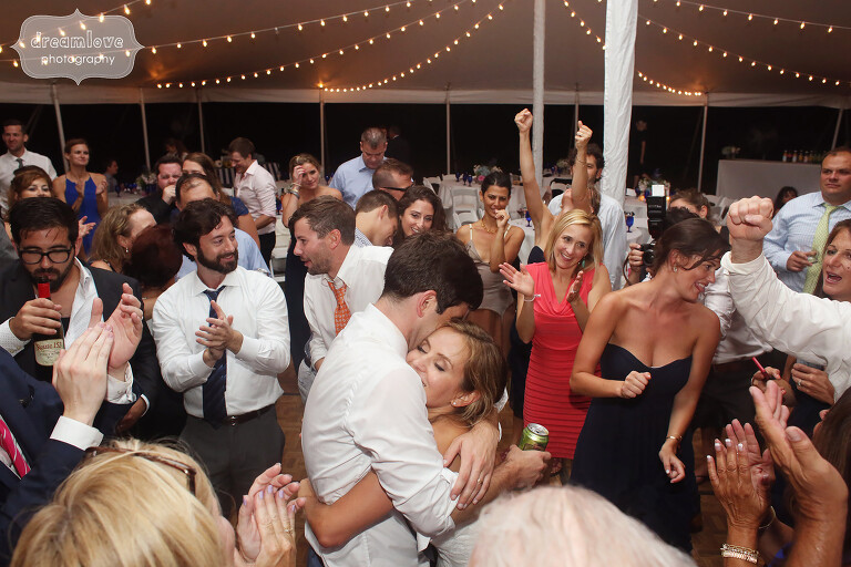Bride and groom hugging in the middle of the dance floor on Cape Cod.