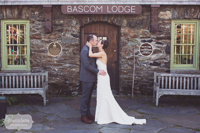 Bride and groom kiss outside of the front door of the Bascom Lodge.
