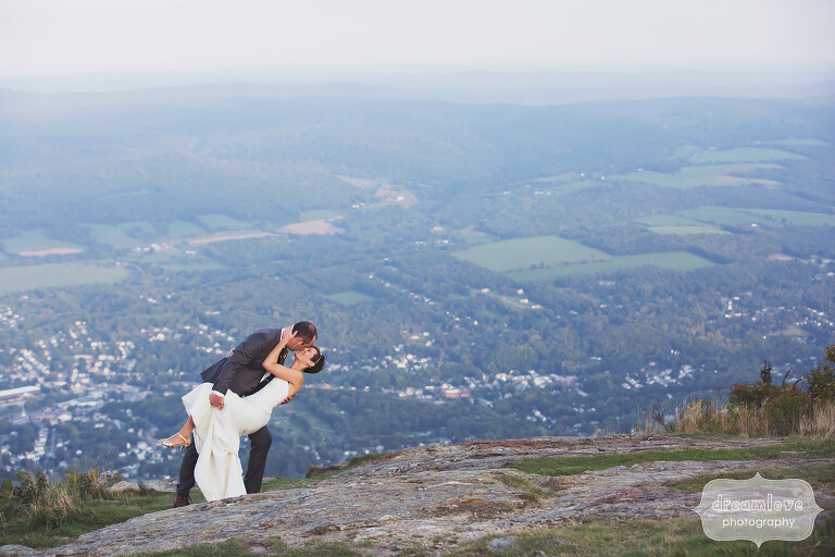 Bride and groom dip photo at this Berkshires mountain wedding venue on Mt. Greylock in MA.