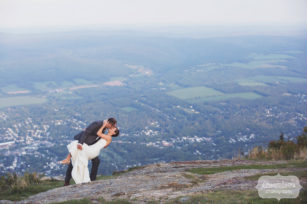 Bride and groom dip photo on the mountaintop wedding venue in the Berkshires.