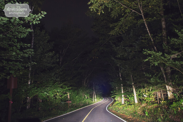 Woodsy wedding venue in the Berkshires, MA with windy road through the forest.