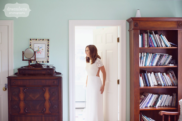 Bride getting ready in antique room at Curtis Hollow Farm in VT.