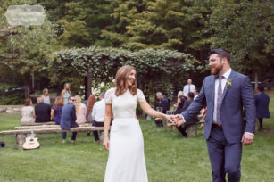 Happy bride and groom exit the ceremony at the Curtis Hollow Farm in Quechee, VT.