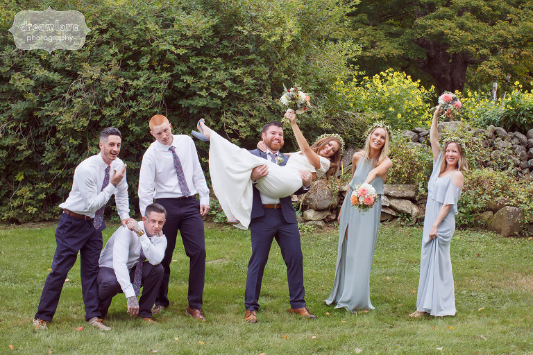 Silly photo of wedding party with groom picking up bride at Curtis Hollow Farm.