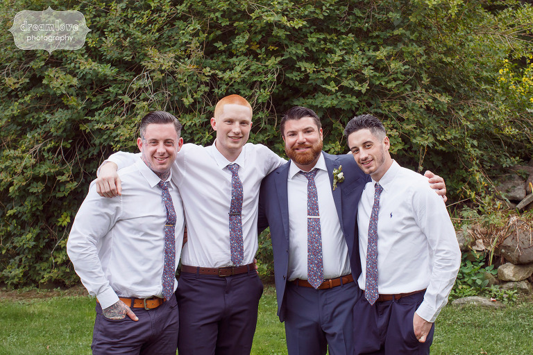 Groomsmen with their arms around each other for wedding in Quechee, VT.