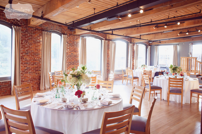 Vermont wedding reception with Anthropologie details and flowers at Simon Pearce Glass Factory.