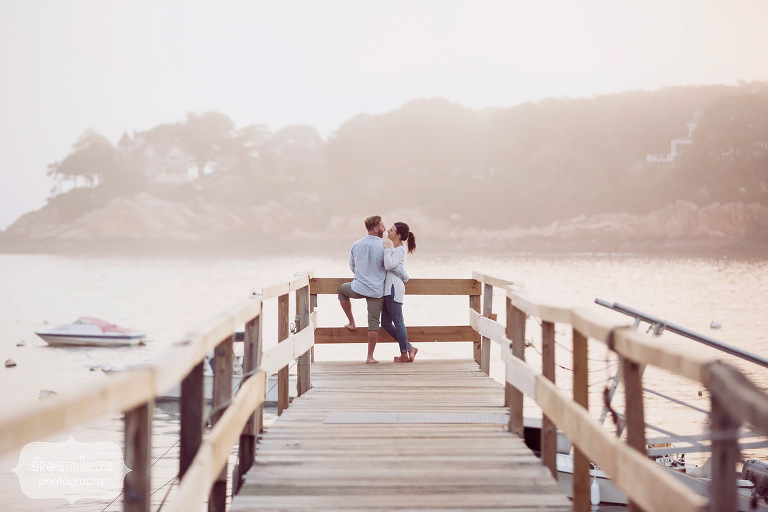 Rustic engagement photography of couple at the end of the pier at the Singing Beach in MA.