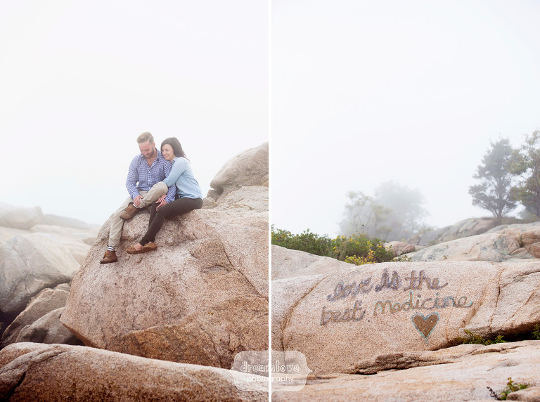 Romantic photo of the couple sitting on the rocks during their Coolidge Reservation engagement session on the coast.