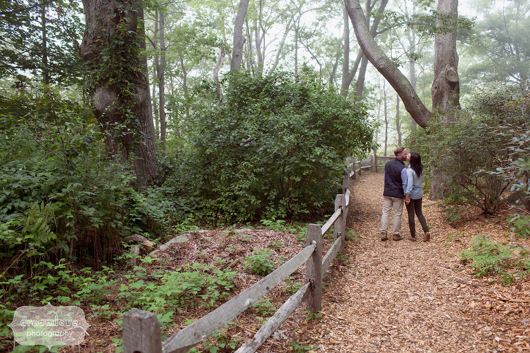 Couple walking along path during a autumn engagement session in MA.