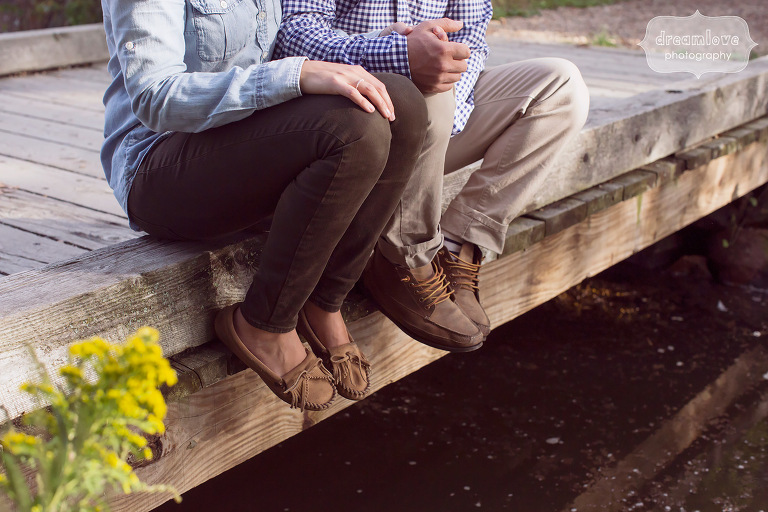 Rustic engagement photography of couple along a bridge in MA.