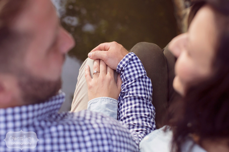 Unique photo of couple holding hands during engagement session in MA.