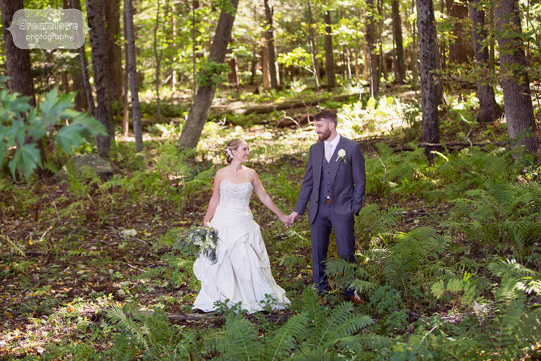 Couple standing in the woods at the Warfield House Inn in western MA.