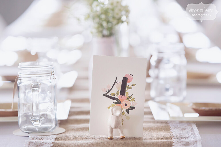 Anthropologie magnetic animal table number holders at the Warfield House Inn wedding in MA.