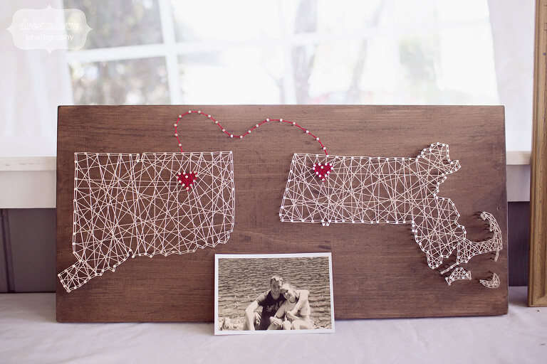 Hipster wedding decor idea of string art with states and hearts of where couple is from at this western MA wedding.