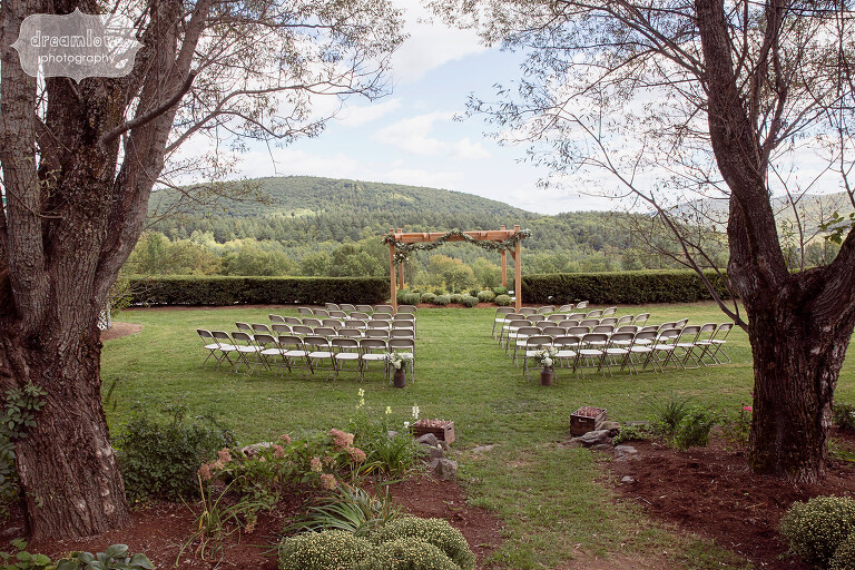 View of the outdoor ceremony space at the Warfield House Inn in western MA nestled in the Berkshire Mountains.