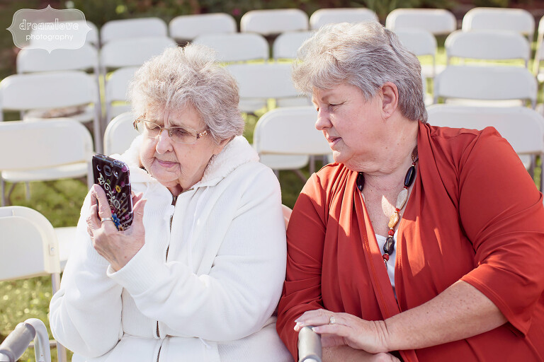 Funny photo of grandma trying to use her cell phone at the wedding at the Warfield House Inn.