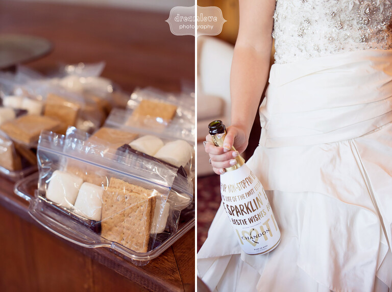 Bride holding a champagne bottle at this outdoor wedding in the Berkshires, paired with smores.