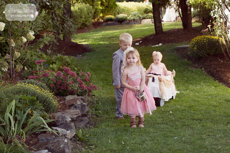 Flower girls and a ring bearer walk down the aisle at the Warfield House Inn.