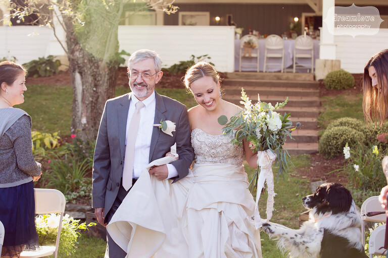 Bride and her dad walk down the aisle at the Warfield House wedding venue.