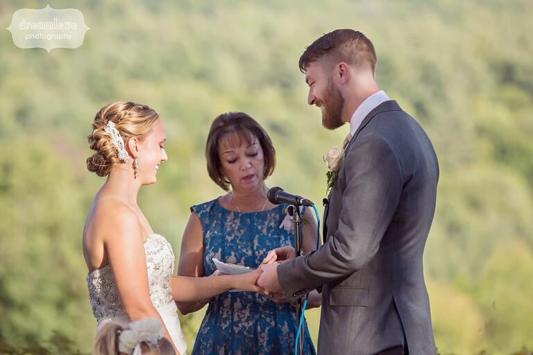 Bride and groom during their ceremony at the Warfield House Inn.