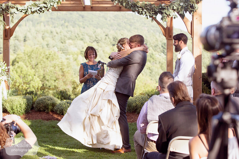 Bride and groom kiss at the end of their outdoor ceremony at the Warfield House Inn.