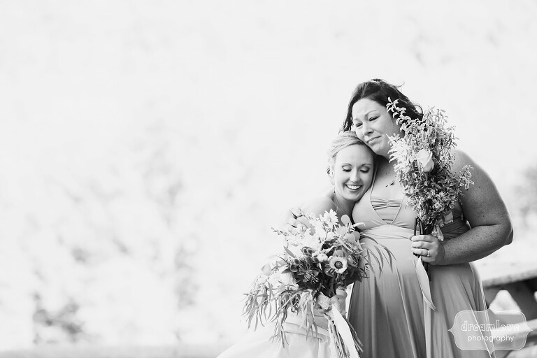 Stunning black and white wedding photo of the bride hugging her sister-in-law at this Warfield House Inn wedding in the Berkshires.