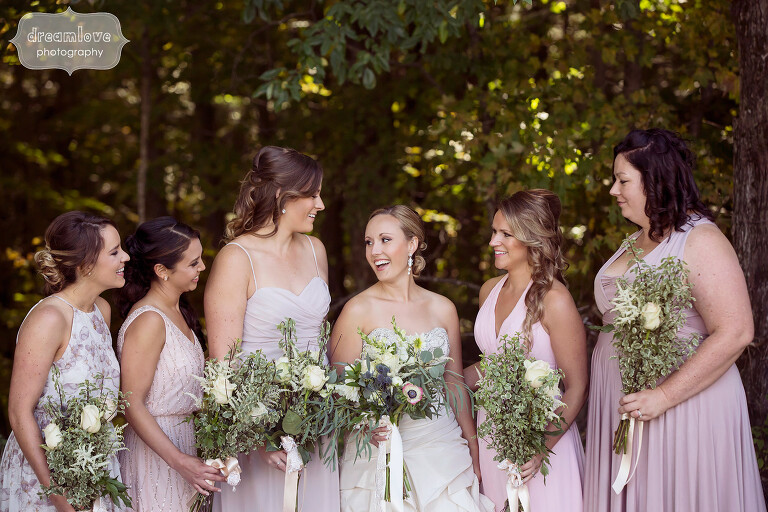 Bridesmaids laughing in the woods at the Warfield House Inn.