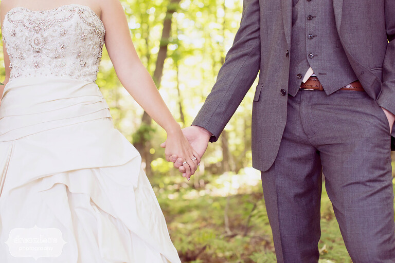 Hipster wedding photo of the bride and groom holding hands at the Warfield House Inn venue.