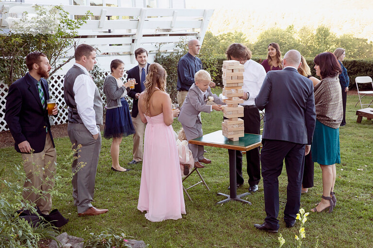 Guests play lawn games like Jenga at this Warfield House Inn wedding in the mountains.