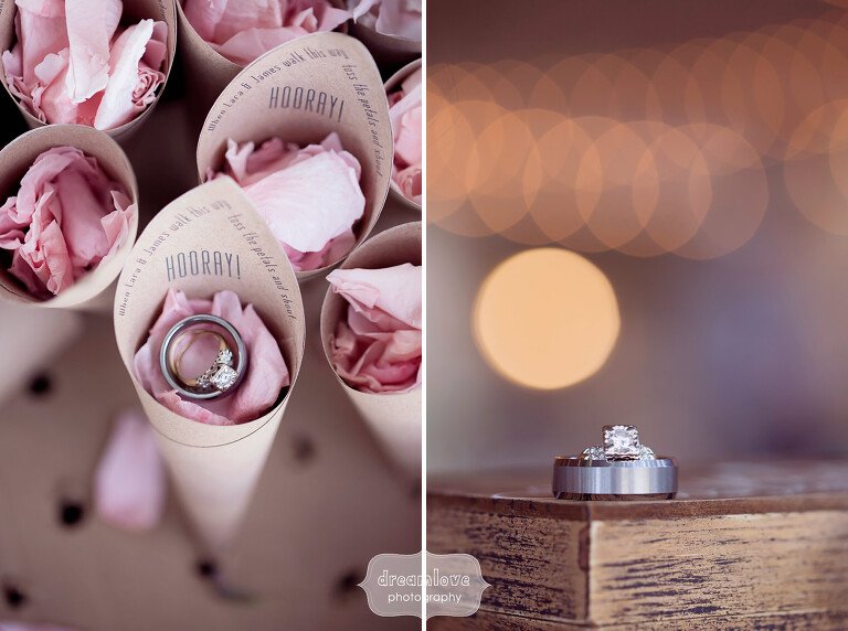 Unique photos of the wedding rings with flower petals and bokeh lights at this Berkshires wedding.