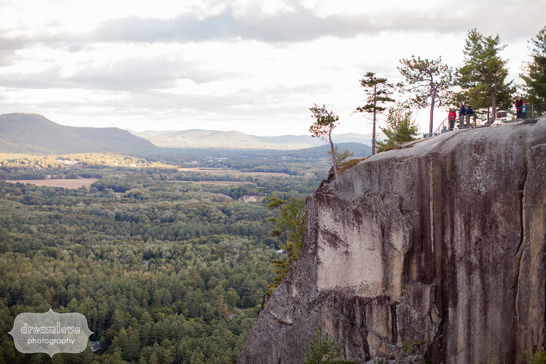 Hikers look out over the Cathedral Ledge climbing spot in Conway, NH.