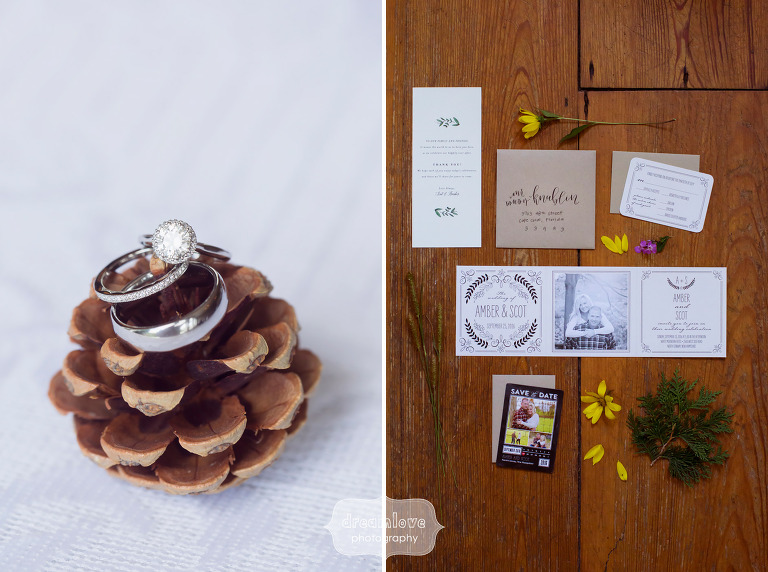 Rustic wedding photos of the rings on a pinecone and the invitations for this White Mountain Hotel wedding.