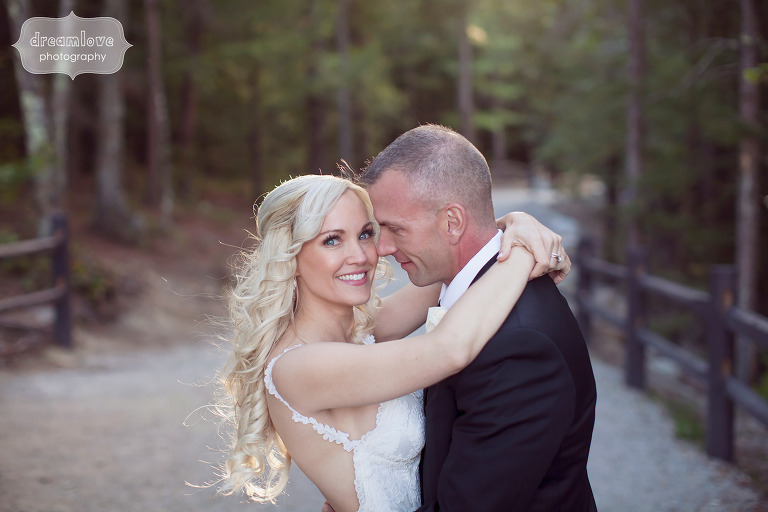 Organic wedding photo of the bride and groom in the woods at Cathedral Ledge.