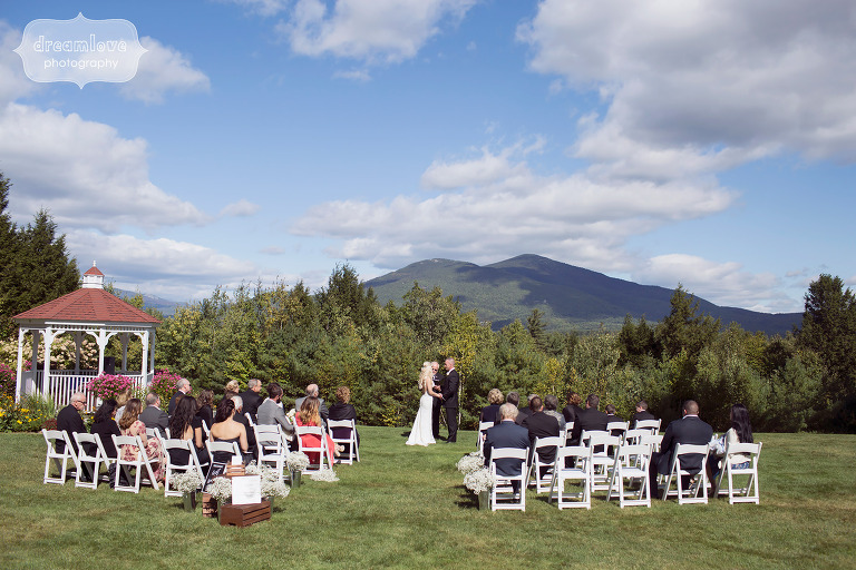 View of an outdoor wedding ceremony at the White Mountain Hotel in Conway, NH.