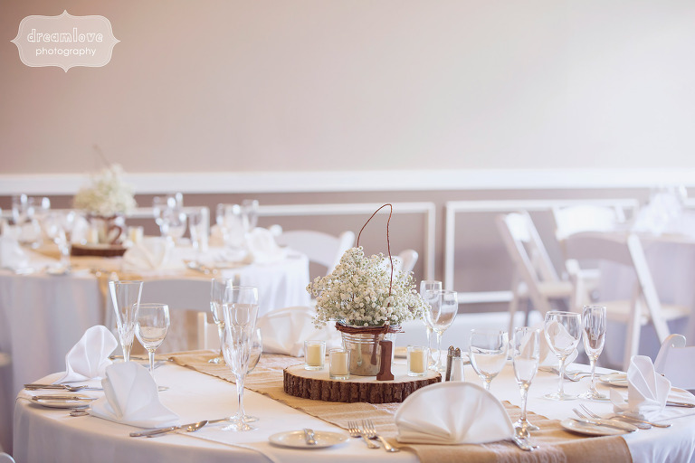 Simple and organic neutral wedding decor at this rustic reception at the White Mountain Hotel.