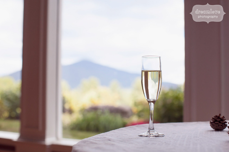 Documentary wedding photo of a wine glass with mountains at the White Mountain Hotel in Conway, NH.