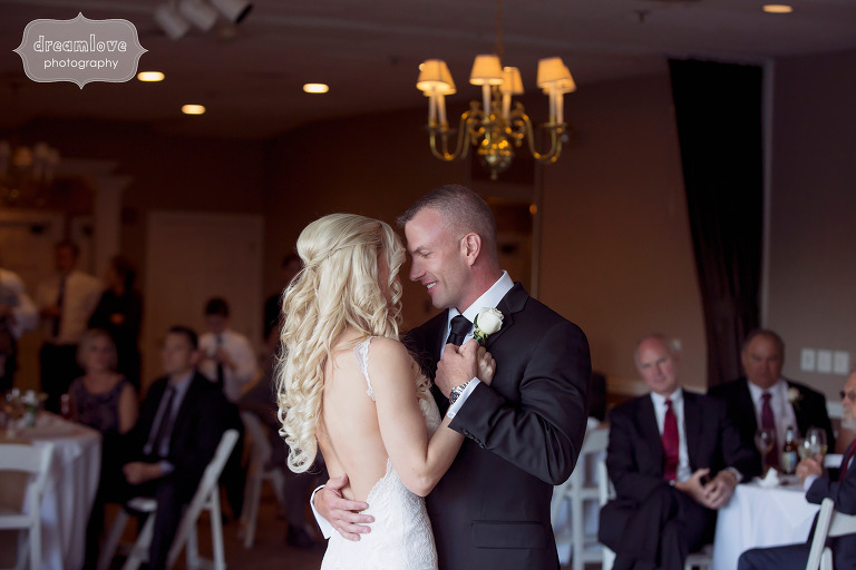 Bride and groom have their first dance in the reception ballroom at the White Mountain Hotel wedding.