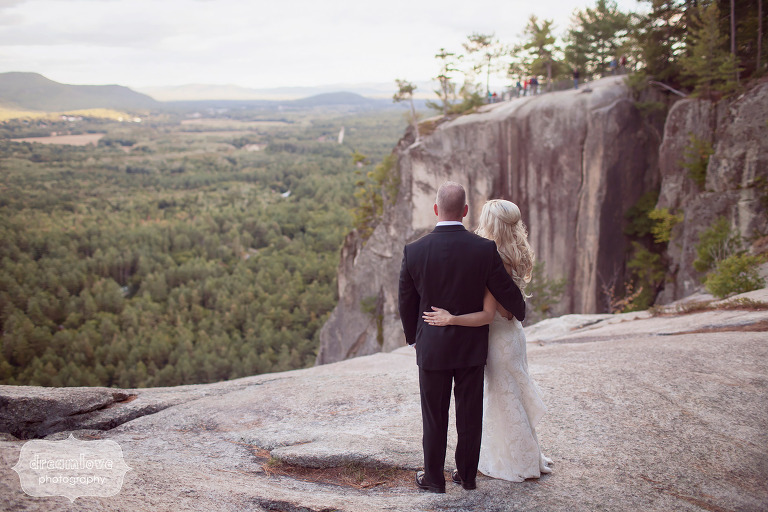 Fine Art Style Wedding Photo Of The Bride And Groom Looking At Mountains From