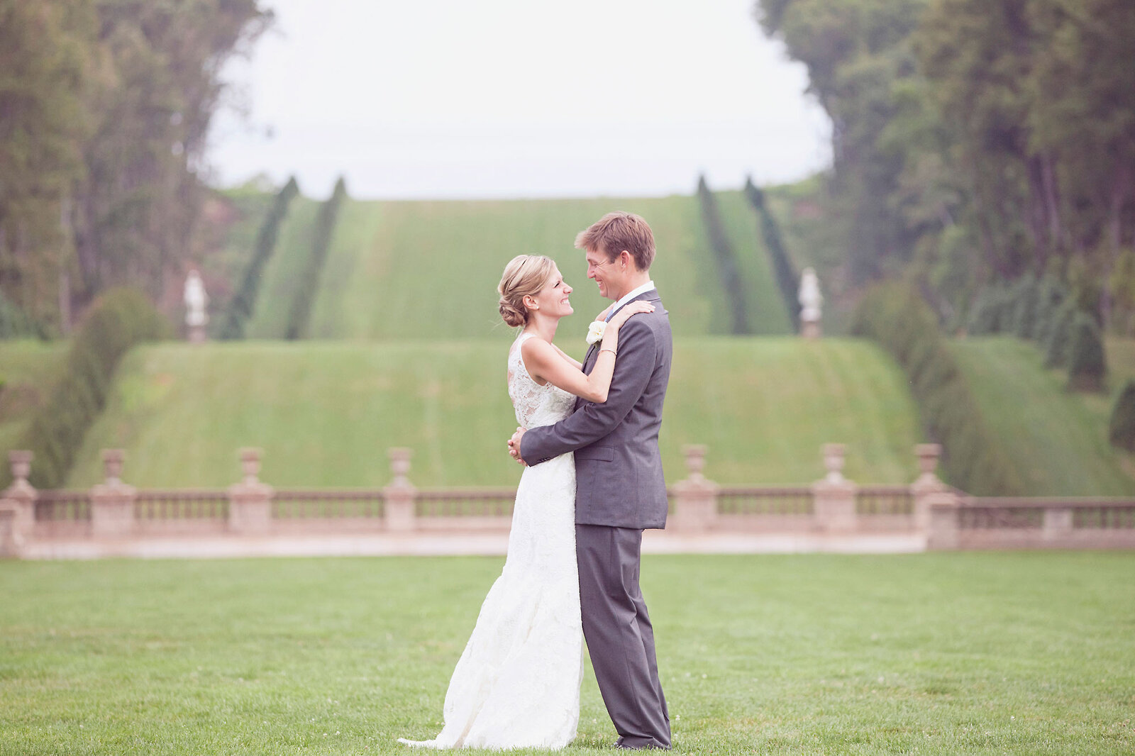 Bride and groom on the lawn of the Great House on Castle Hill at the Crane Estate.