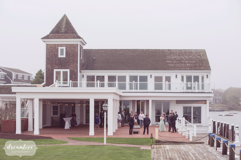 View of the outside of the Wychmere Resort for a wedding reception with an ocean view.