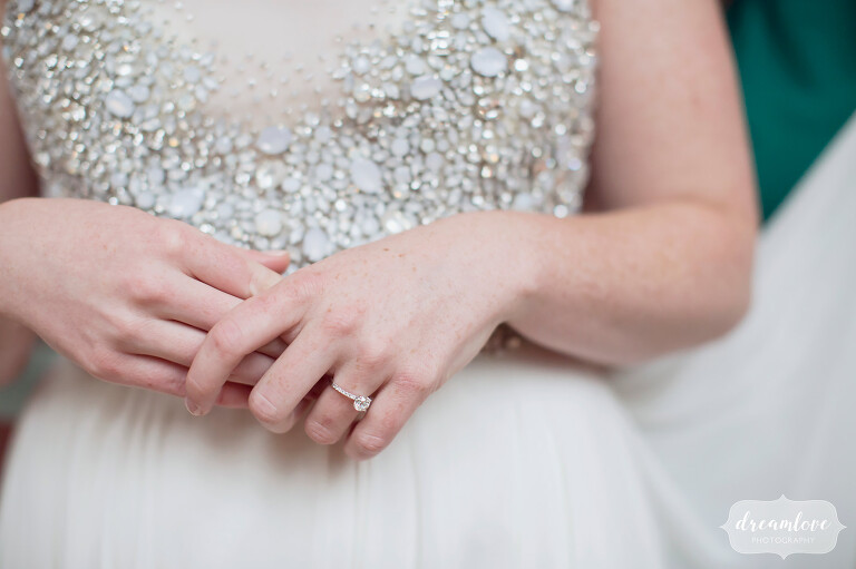 Simple wedding photography of the bride's hands on her sparkle dress at this Cape Cod spring wedding.