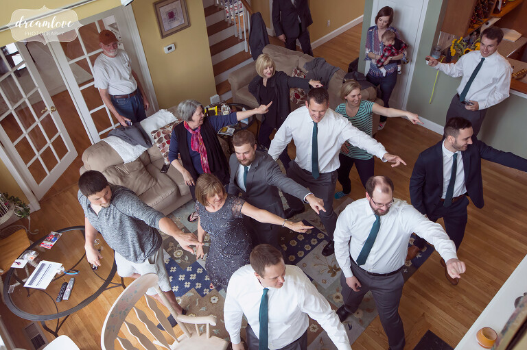 We love this candid and funny photo of the groom and his guys doing a choreographed dance before the ceremony.