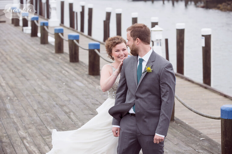 The bride taps the groom on the shoulder during their first look at this natural Wychmere wedding on Cape Cod.