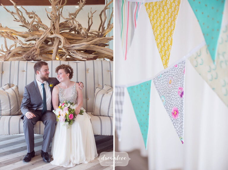 Colorful Cape Cod wedding portrait of bride and groom at Wychmere with driftwood and handmade pennants.
