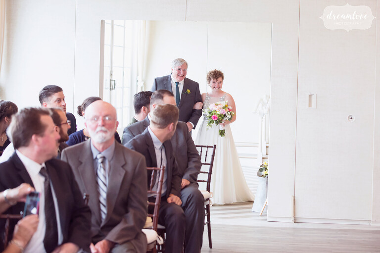 Bride and her father walk down the aisle during the indoor ceremony at the Wychmere.