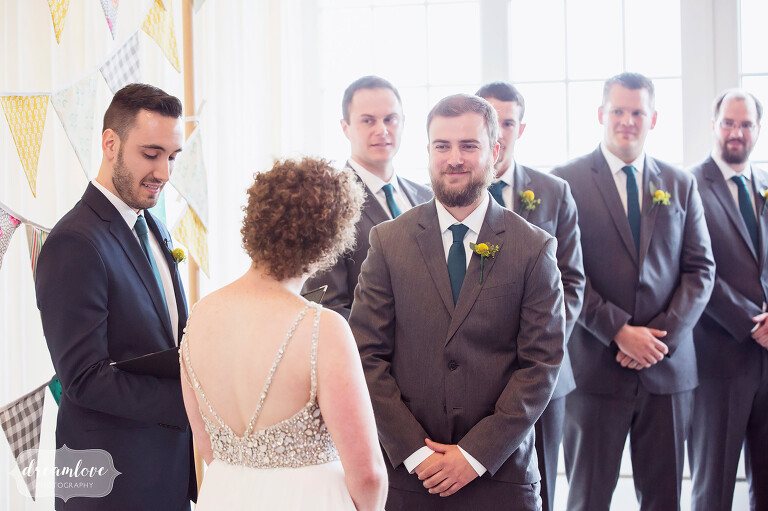 Bright and modern ceremony with the bride and groom at this Cape Cod wedding.