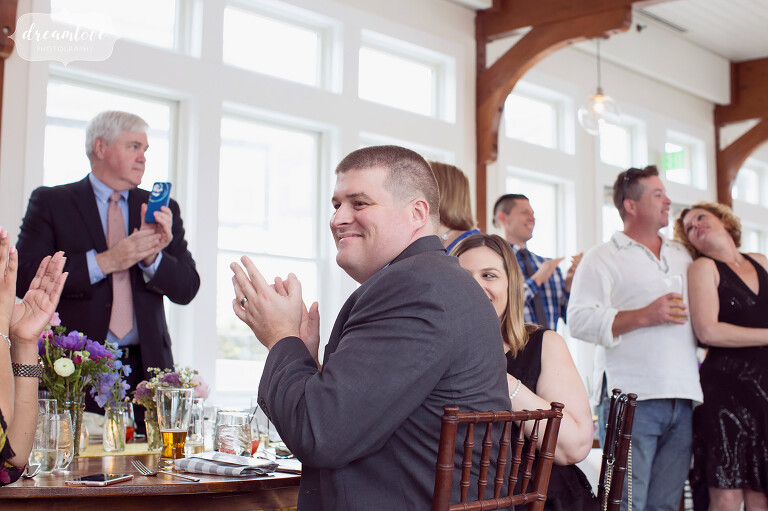 Guests enjoy the speeches at this luxury wedding venue on Cape Cod.