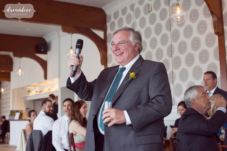 Documentary wedding photography of the father of the bride giving a toast at this Cape Cod wedding.